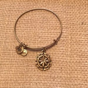 New, gold, compass charm bracelet. Alex and Ani